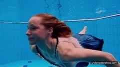 Kinky Teen girl Avenna is swimming in the pool Thumb